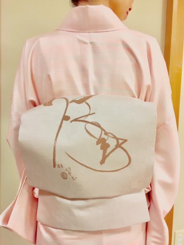 帯はよく見ると『久美子』と書かれています