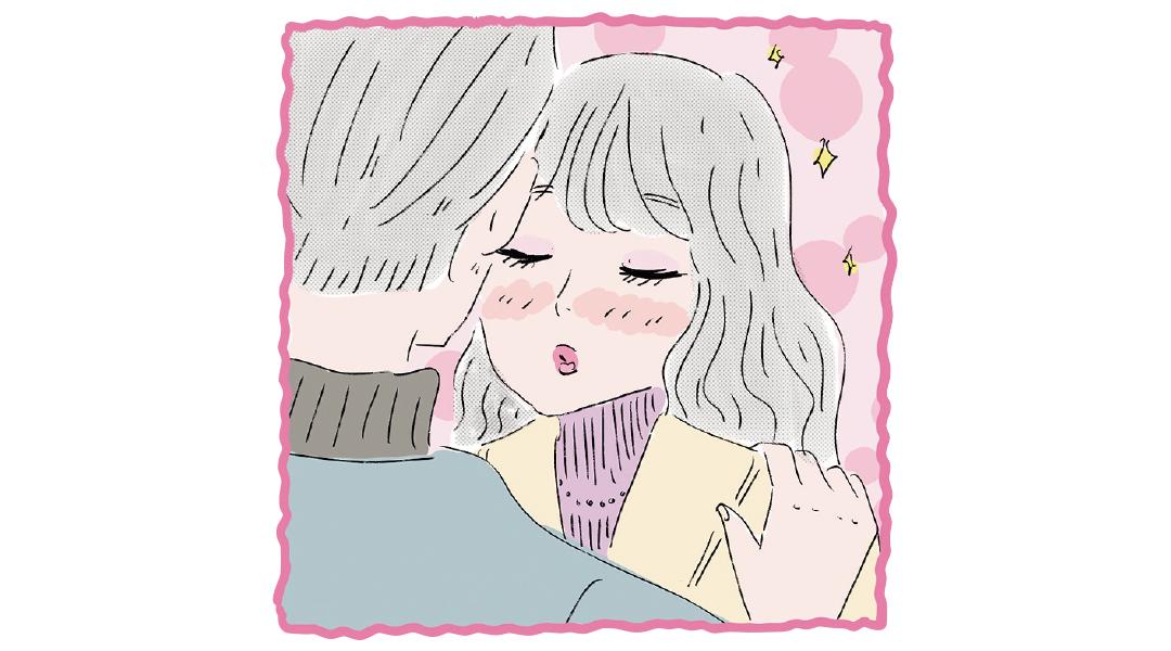 男性にキスをしようしている女性