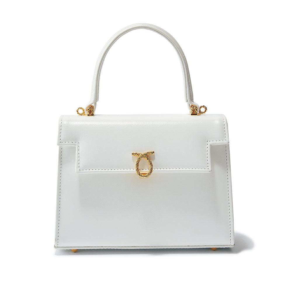 フェミニン派のためのファッション小物はロウナー ロンドンの白いハンドバッグ