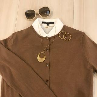 Cardigan UNIQLO / Shirt GUCCI / Necklace GUCCI / Earrings GUCCI / Sunglasses GUCCI